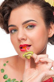 Close up portrait of young emotional woman with kiwi canape — Stock Photo