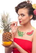 Close up of young woman that drink pineapple & grapefruit juice. — Stock Photo