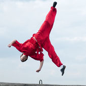 Wushoo man in red practice martial art — Stock Photo