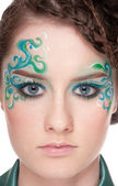 Close-up portrait of sprite girl with faceart — Stock Photo