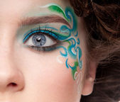 Half face portrait of sprite girl with faceart — Stock Photo