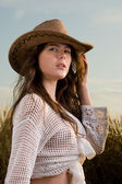 Slavonic girl in cowboy clothes — Stock Photo