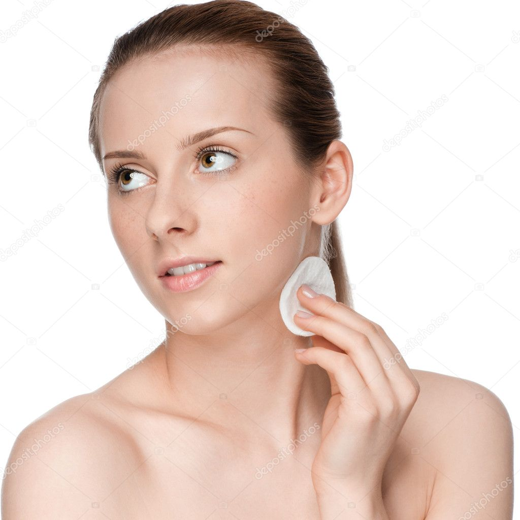 Closeup portrait of young beautiful woman with perfect skin. Applying clean sponge. Isolated — Stock Photo #8461545