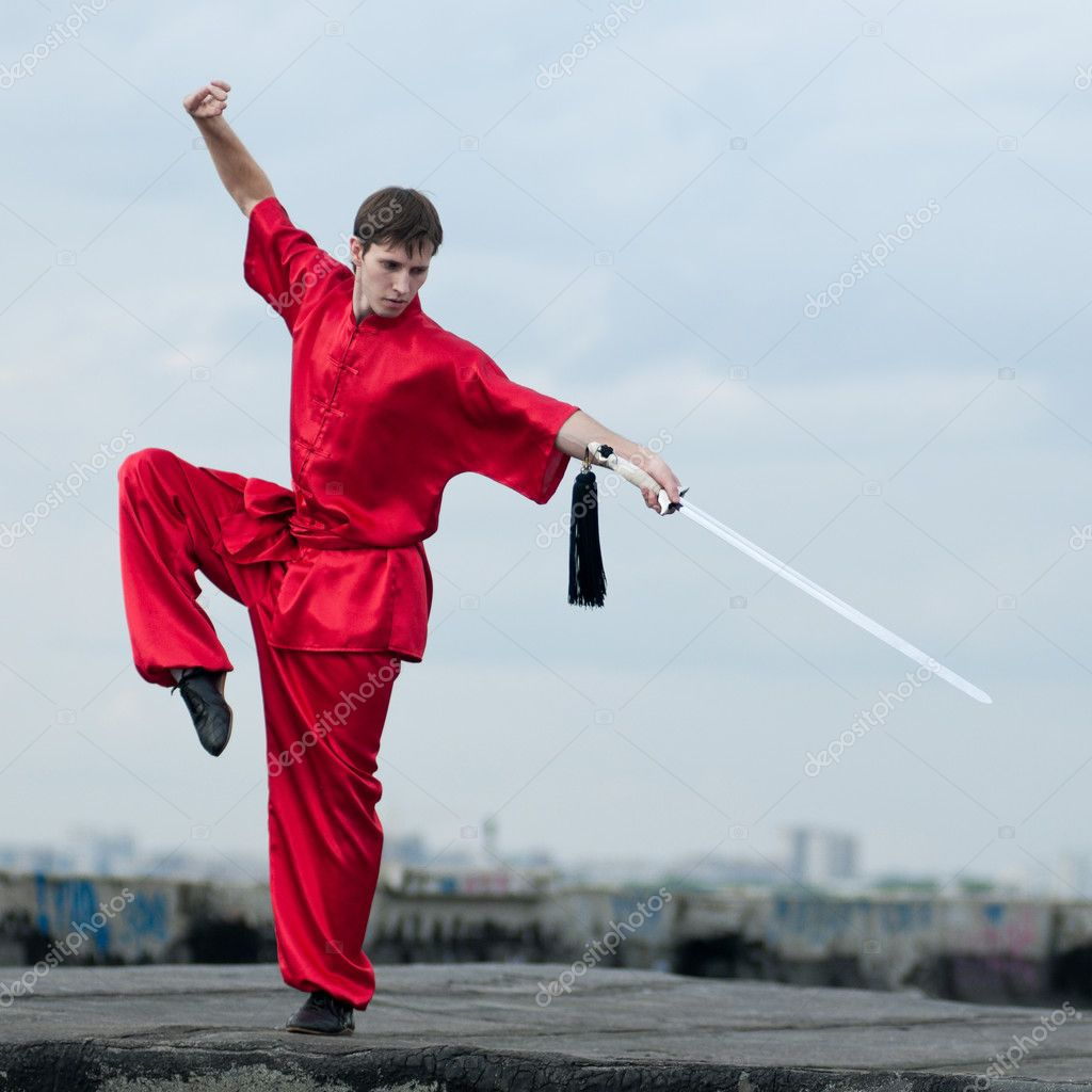 Shaolin warriors wushoo man in red with sword practice martial art outdoor. Kung fu — Stock Photo #8466050