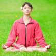 Teenage girl doing yoga exercise — Stock Photo #8529915