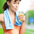 Girl drinking juice after exercise — Stock Photo #8529999