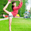 Stock Photo: Girl doing stretching exercise. Yoga