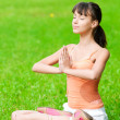 Teenage girl doing yoga exercise - Lizenzfreies Foto