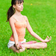 Teenage girl doing yoga exercise - Photo
