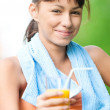 Girl drinking juice after exercise — Stock Photo