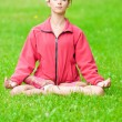 Stock Photo: Teenage girl doing yoga exercise