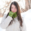Beautiful girl in green over winter landscape — Stock Photo