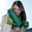 Girl on winter picnic with cup of hot tee and thermos — Stock Photo #8530602