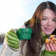 Girl on winter picnic with cup of tee and cookies — Stock Photo #8530607
