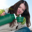 Girl on winter picnic with cup of hot tee and thermos — Stock Photo