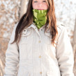 Beautiful girl in green over winter landscape — Stock Photo #8530692