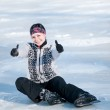 Ice skating woman sitting on ice — Stock Photo #8531085