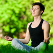 A young man doing yoga exercise — Stock Photo