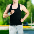 Young man jogging in park — Stockfoto