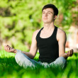 A young man doing yoga exercise — Stock Photo #8531325