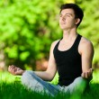 A young man doing yoga exercise — Stock Photo #8531336