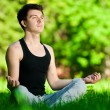 A young man doing yoga exercise — Stock Photo #8531346