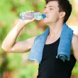 Man drinking water after fitness — Stock Photo #8531349