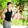 Young man jogging in park - Foto Stock
