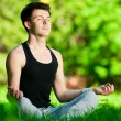 Stock Photo: A young man doing yoga exercise