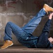 Hip hop dancer in modern style over brick wall — Foto de Stock