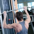 Powerful muscular man lifting weights in gym — Stock Photo #8532628