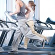 Stock Photo: Young womand mat gym exercising. Running