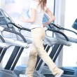 Young woman at the gym exercising. Running - 