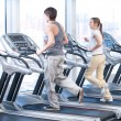 Young woman and man at the gym exercising. Running - Stockfoto