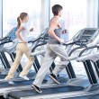 Young woman and man at the gym exercising. Running — Stock Photo #8532896