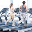 Young woman and man at the gym exercising. Running — Stock Photo #8532918