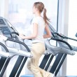 Young woman at the gym exercising. Running - Foto Stock