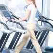 Young woman at the gym exercising. Running — Stock Photo