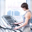 Young man at the gym exercising. Running - 