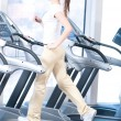 Young woman at the gym exercising. Running - Stockfoto