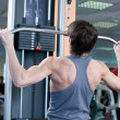 Powerful muscular man lifting weights in gym — Foto de Stock