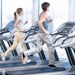 Young woman and man at the gym exercising. Running — Stock Photo #8533073