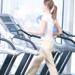 Young woman at the gym exercising. Running — Foto Stock