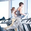 Young woman and man at the gym exercising. Running - Foto Stock
