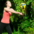 Beautiful woman playing volleyball — Stock Photo