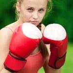 Yyoung boxer woman at green park — Stock Photo