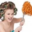 Angry woman in hair rollers is holding swab — Stock Photo