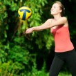 Beautiful woman playing volleyball - 