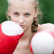 Yyoung boxer woman at green park - Stock Photo