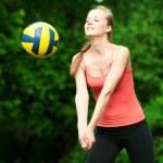 Beautiful woman playing volleyball — Stock Photo #8533670